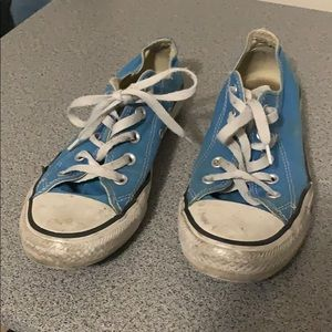 Woman's blue and white low top converse